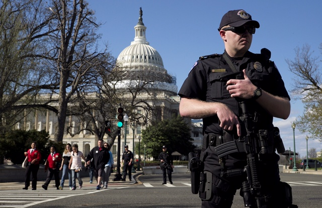 A U.S. Capitol police officer guards the perimeter in front of the U.S. Capitol Building after a shooting at the U.S. Capitol Visitors Center in Washington